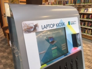 photo of laptop kiosk at a local library